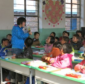 A teacher in China reading to her students after completing LEAPAsia's reading aloud workshop.